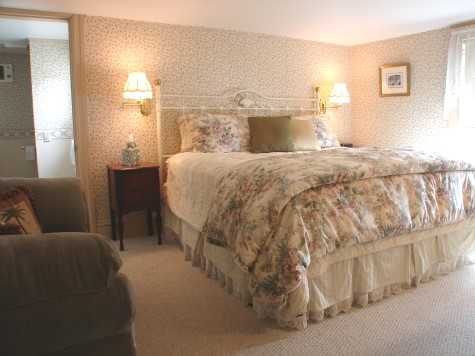 The Lyndhurst, a spacious and bright king room on the first floor with views of open field. Colors are cream, light sage and rose. Room also has antique large dresser and sage micro-fiber loveseat