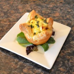 Fresh Spinach, Roasted Red Pepper, Feta and Swiss in Puff Pastry Blossom an example of a Hot Entree selection. Each day our 2nd course lets guests choose between a Hot Savory or Sweet Entree which is accompanied by a side of Breakfast Meat or Salad or Roasted Potatoes